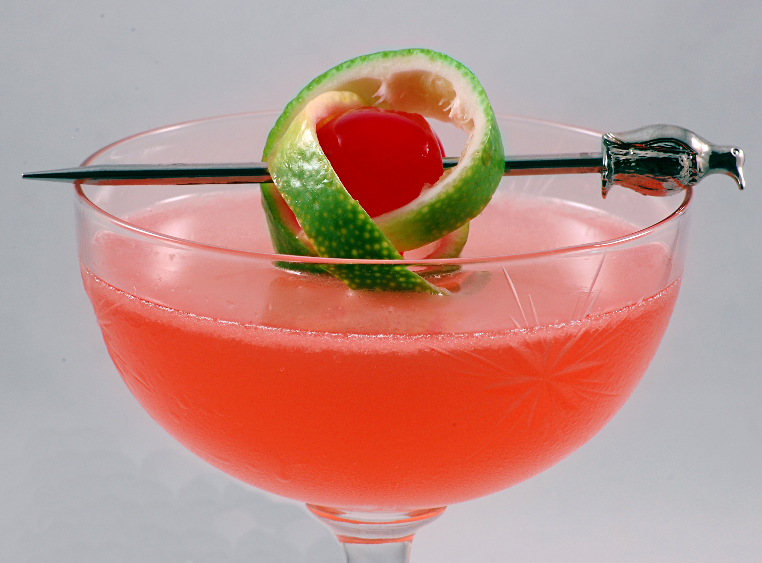 Pink_Lady_with_a_twist_of_lime,_in_a_cocktail_glass