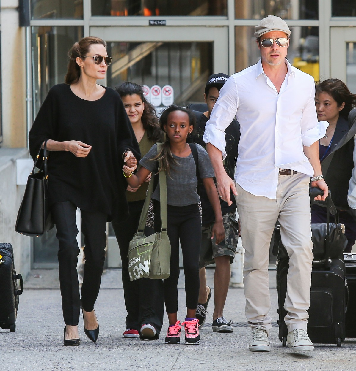 Angelina Jolie & Brad Pitt With Zahara and Maddox Arrive on a Flight at LAX