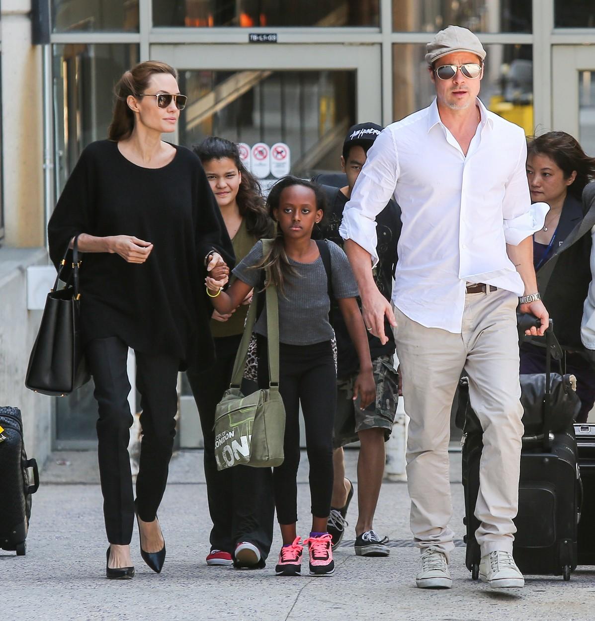 Angelina Jolie & Brad Pitt With Zahara and Maddox Arrive on a Flight at LAX