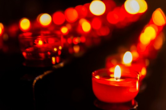 Lighted votive candles in a church