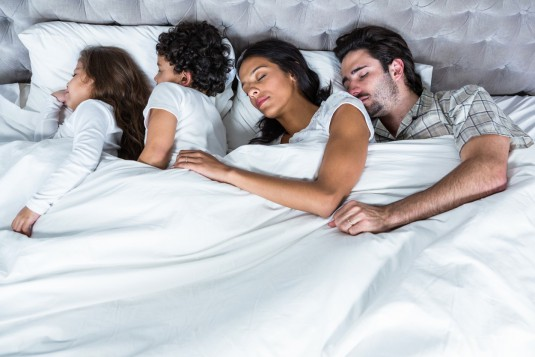 Family sleeping together