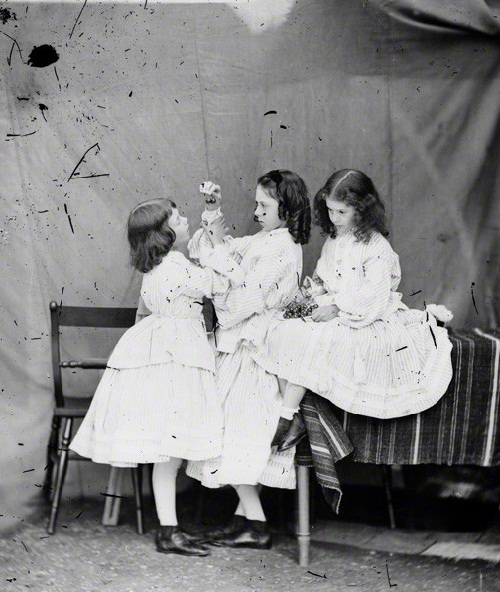 Alice Liddell (right) with his sisters. Photo by Lewis Carroll, 1860
